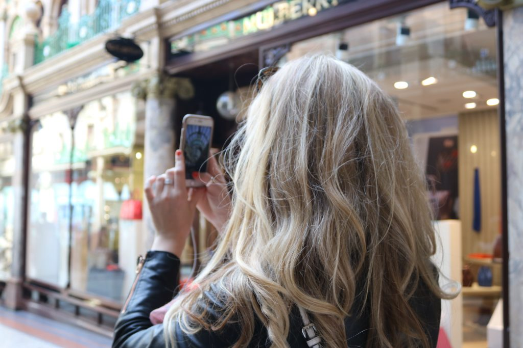Jen Lowthrop taking photos in Leeds arcade