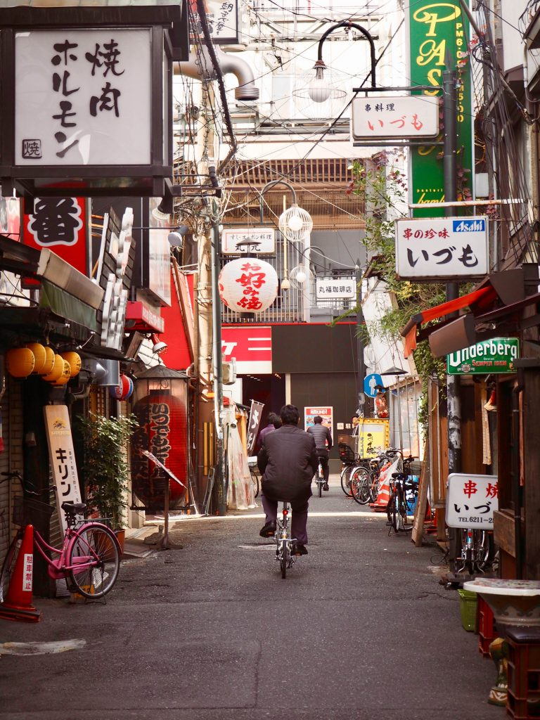 Osaka City centre - man on bike